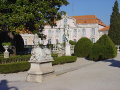 Queluz_Palace_sphynx_statue_and_ballroom_wing