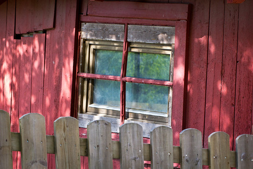 Window of a small red cottage