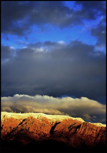 sunset sky snow newmexico clouds albuquerque peak fk sandiamountains andthiswasit itrainedmostofthetimeiwasthere butwehadonebriefglimmerofasunset andseeingitmademeunderstandwhyalbuquerquianslovetheirskies