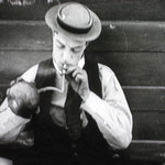 buster keaton lights a cigarrette using an explosive