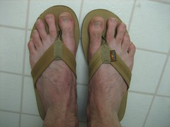My feet in sandals on a floor
