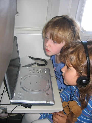 Children on Plane Watching Movie