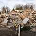 Piles of smashed up homes by Elliott Plack