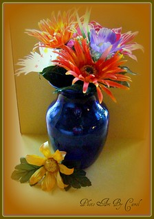 Blue vase filled with Flowers