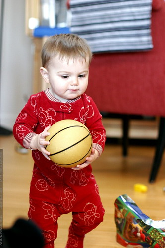 holding a baby basketball    MG 7269