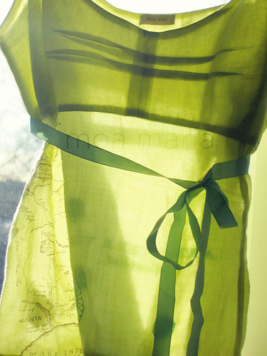 Sunlight through sheer lime green top