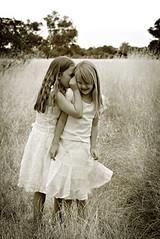 Girls whispering in ear