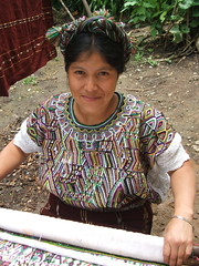 Catarina Matom Brito showing her weaving near Nebaj