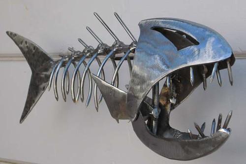 Metal fish closeup of small skeletal fish by for Metal fish art