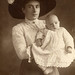 Mother in spectacular hat with baby