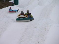 vehicle(0.0), winter sport(1.0), winter(1.0), tubing(1.0), sports(1.0), recreation(1.0), snow(1.0), outdoor recreation(1.0), sledding(1.0), sled(1.0),