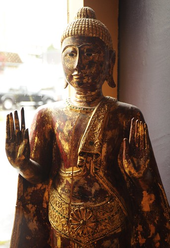 Thai Buddha statue in the abhaya mudra, wood with gold, Uma Thai restaurant, Ballard, Seattle, Washington, USA by Wonderlane