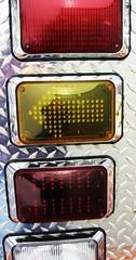 accordion(0.0), automotive exterior(0.0), grille(0.0), bumper(0.0), vehicle registration plate(0.0), automotive tail & brake light(1.0), red(1.0),