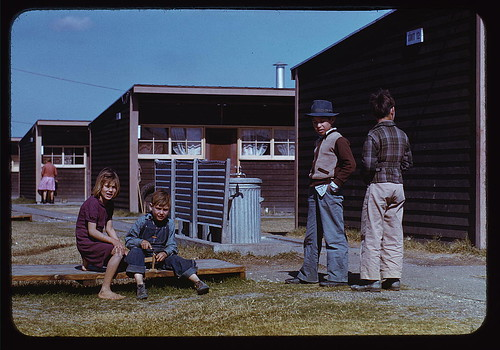 Boy building a model airplane while other children look on, FSA labor camp, Robstown, Tex. (LOC)