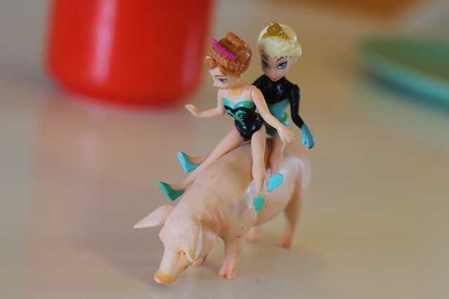 elsa and anna on a pig