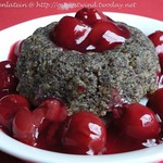 Poppy seed pudding with cherry compote