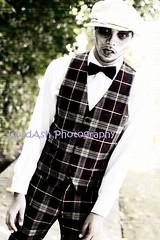 formal wear(0.0), pattern(1.0), clothing(1.0), male(1.0), outerwear(1.0), fashion(1.0), photo shoot(1.0), design(1.0), tartan(1.0), gentleman(1.0), plaid(1.0),