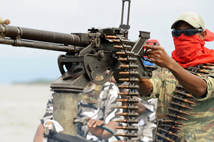 "Nigerian rebels have threatened an ""all out war"" in the oil-producing regions of the country. The rebels point to the environmental degradation and exploitation of petroleum resources as the basis of their struggle. by Pan-African News Wire File Photos"