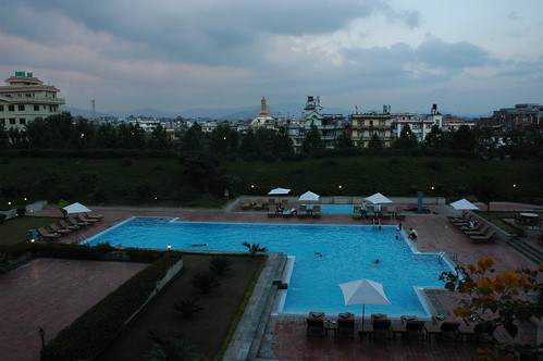 Large swimming pool in view of the Boudha Stupa, in the evening, Hyatt Regency Hotel, Boudha, Kathmandu, Nepal by Wonderlane