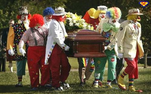 clowns carry coffin