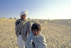 Man and boy on grazing land