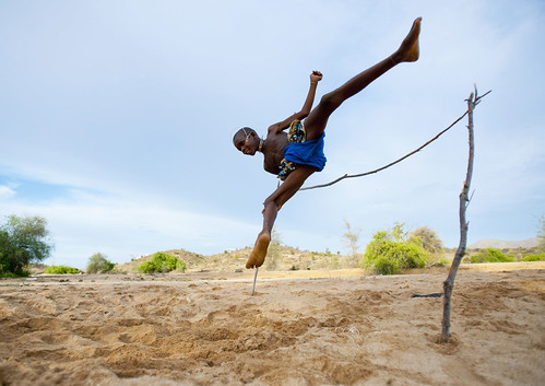 Mukubal Kid Doing High Jumping, Virie Area, Angola