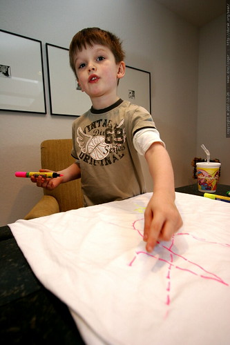 """this is a pink airport""   nick, making a shirt for sean    MG 7866"