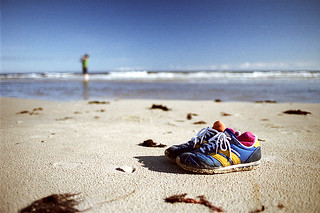 Image of Sandy beach. ocean sun beach sand shoes