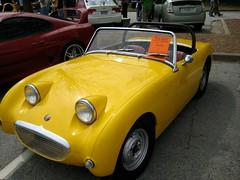 race car(1.0), automobile(1.0), vehicle(1.0), automotive design(1.0), antique car(1.0), austin-healey sprite(1.0), land vehicle(1.0), convertible(1.0), sports car(1.0),