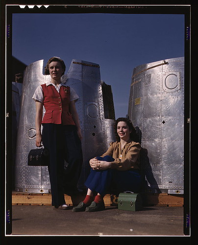 Two assembly line workers at the Long Beach, Calif., plant of Douglas Aircraft Company enjoy a well-earned lunch period, Long Beach, Calif. Nacelle parts of a heavy bomber form the background  (LOC)