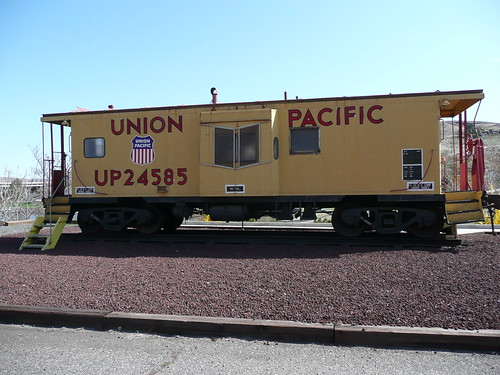 park heritage public wheel yellow oregon arlington train outside outdoors track view pacific display outdoor antique or union transport exhibit caboose sidewalk transportation end pacificnorthwest showing exhibits gravel relic displaying wheeles reacks