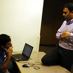 Joe (developer) and Amol (Test manager), software team discuss software issues Microsoft, Redmond, Washington state, USA