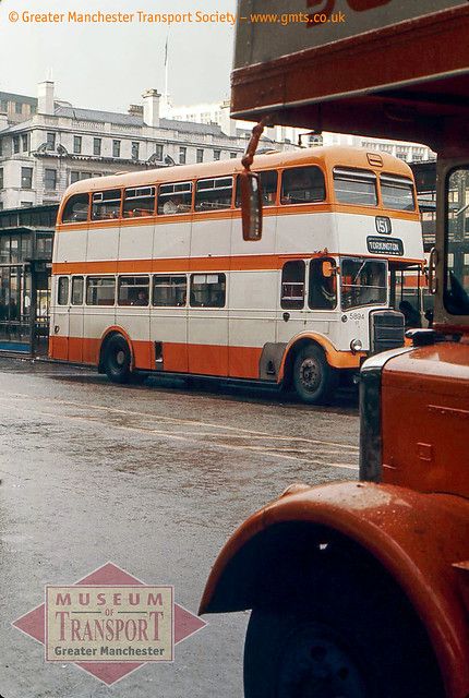 Titans in the rain, Piccadilly bus station