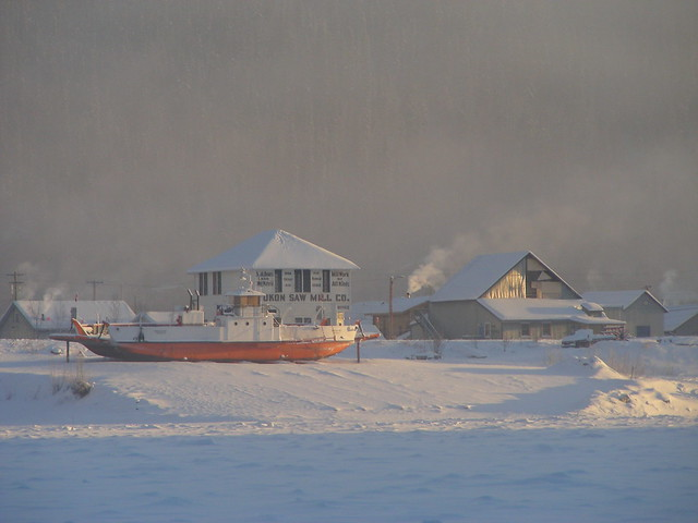 Town and Dry docked Ferry in Ice fog