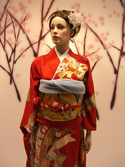 geisha(0.0), dress(0.0), art(1.0), flower(1.0), clothing(1.0), costume design(1.0), kimono(1.0), woman(1.0), fashion(1.0), female(1.0), costume(1.0), person(1.0), pink(1.0),