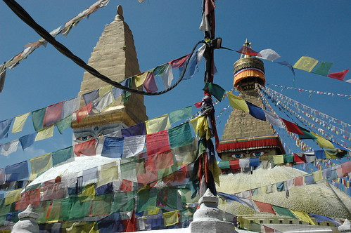 The eastern eyes of Lord Buddha, Boudha Stupa, the Wish Fullfilling, prayer flags old and new, power cable, clear sunny day, Tibetan Buddhism, Kathmandu, Nepal by Wonderlane