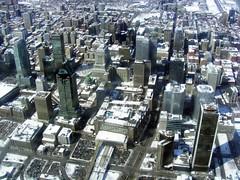 suburb(0.0), mecca(0.0), plaza(0.0), traffic congestion(0.0), tower block(1.0), metropolitan area(1.0), urban design(1.0), bird's-eye view(1.0), skyscraper(1.0), metropolis(1.0), urban area(1.0), cityscape(1.0), skyline(1.0), aerial photography(1.0), city(1.0), downtown(1.0), neighbourhood(1.0),