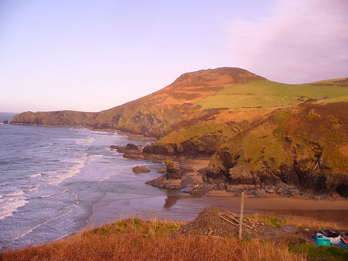 Llangrannog beach with Ynys Lochtyn and Hillfort in distance