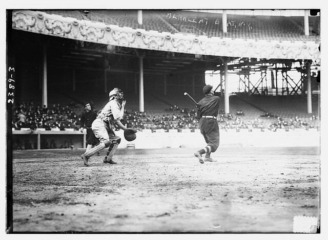 [Fred Merkle (New York NL) at bat, Red Murray (New York NL) walking in background, and unidentified catcher at the Polo Grounds, NY, 1911 World Series (baseball)] (LOC)