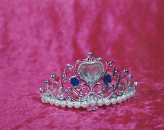 clothing(0.0), crown(1.0), jewellery(1.0), headpiece(1.0), tiara(1.0), pink(1.0), headgear(1.0),