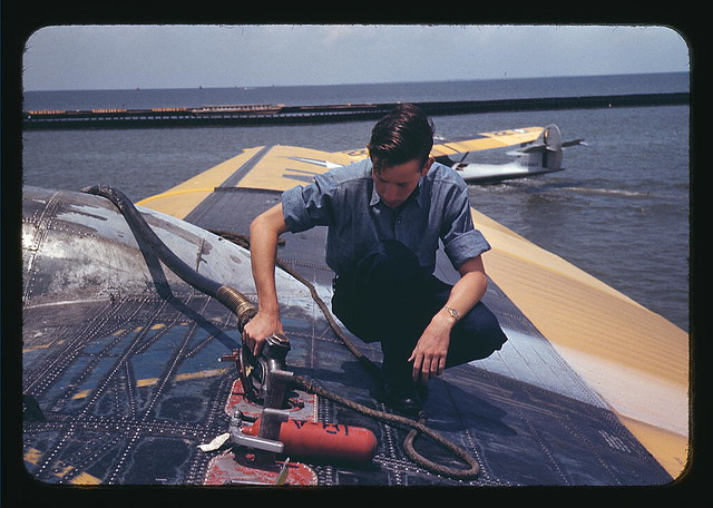A sailor mechanic refueling a plane at the Naval Air Base, Corpus Christi, Texas (LOC)