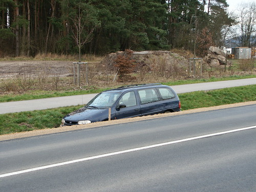 accident car at a fresh roundabout - side view