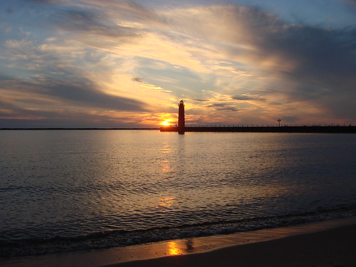 sunset sun lighthouse reflection love beach water clouds port gold golden harbor sand bravo surf peace waterfront searchthebest michigan shoreline lakemichigan harmony sailorsdelight 888 channel muskegon celinedion incroyable peremarquettepark supershot anawesomeshot tiossealofapproval betterthangood lighthousetrek stunningplanetearth haveyoueverbeeninlove flickr888 muskegonsouthpierlightstation iamsocrackingmyselfup sandinmyshorts