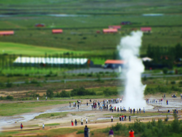Little people watching the Geyser
