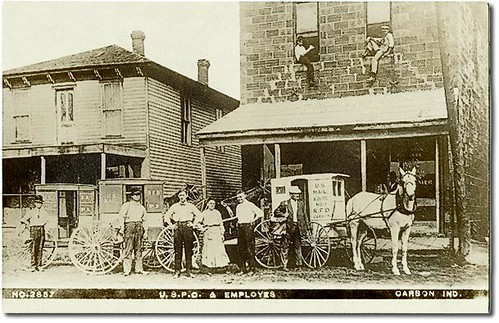 horses people woman usa signs man men history boys kids buildings advertising children clothing women mail postoffice indiana streetscene transportation porch shops storefronts carbon businesses wagons claycounty realphoto hoosierrecollections