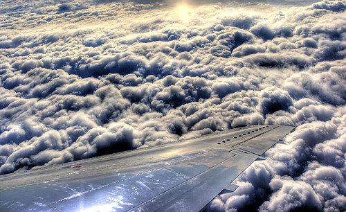 blue sky usa cloud sun white snow newyork abstract window boston clouds plane canon landscape geotagged landscapes fly unitedstates massachusetts wing hdr tonemapping sigma1770 rebelxti400d