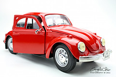 model car(1.0), automobile(1.0), volkswagen beetle(1.0), automotive exterior(1.0), wheel(1.0), vehicle(1.0), automotive design(1.0), city car(1.0), antique car(1.0), vintage car(1.0), land vehicle(1.0),