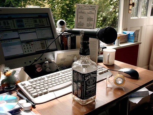 This is how I used to broadcast to the world. Just me, a computer and a microphone sellotaped to a bottle of Jack Daniels. Livin' the dream.