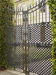 outdoor structure(0.0), chain-link fencing(0.0), fence(0.0), picket fence(0.0), home fencing(1.0), gate(1.0), iron(1.0),