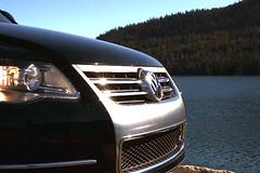 sport utility vehicle(0.0), wheel(0.0), vehicle registration plate(0.0), automobile(1.0), automotive exterior(1.0), volkswagen(1.0), vehicle(1.0), grille(1.0), volkswagen touareg(1.0), bumper(1.0), land vehicle(1.0), luxury vehicle(1.0),